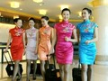 "Aren't they lovely? ""Cheongsam"" is in Cantonese dialect meaning ""long dress"". ""The present day cheongsam has come a long way through its 300 years' journey from a conservative loose fitting dress covering from neck to toes, to a modern no-holds-barred piece of high-society fashion icon."" Image: Air Hostesses of China's Sichuan Airlines #Asianfashion #fashionandbeauty #fashionandstyle"