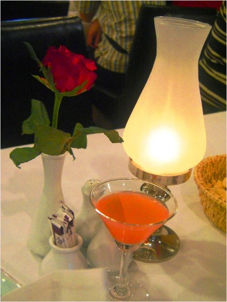 An elegant lamp and orchid centerpiece at the cruise ship
