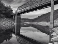 Lake level #california #folsomlake #salmonfallsbridge #eldoradocounty #landscape #bridge #reflection #blackandwhite #blackandwhitephotography #iphonegraphy #water
