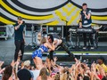 Matt & Kim embrace a fan on stage at the 2016 @mopopfestival !
